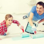 couple painting interior 10 tips to sell your home