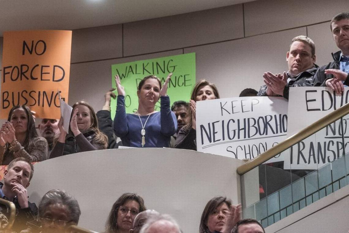 Neighborhood schooling supporters protesting at student assignment hearing cms